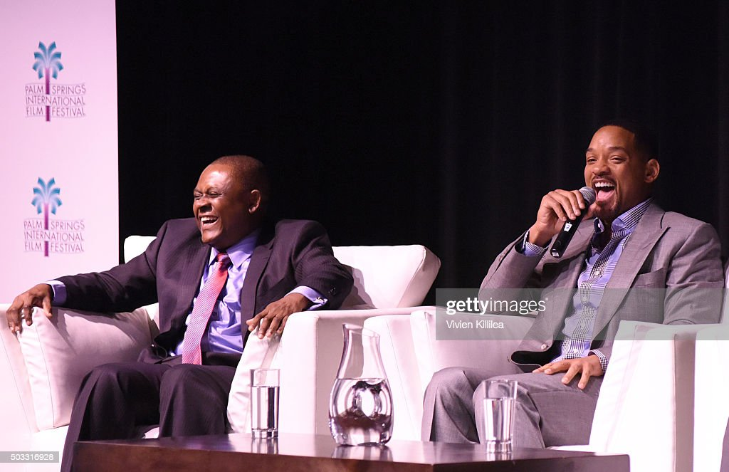 Dr. Bennet Omalu and actor Will Smith speak at a screening of 'Concussion' at the 27th Annual Palm Springs International Film Festival on January 3, 2016 in Palm Springs, California.