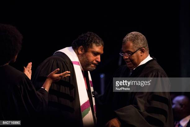 Dr Bernard L Richardson Howard University Dean of the Chapel reaches out to touch guest preacher Bishop William J Barber II Pastor Greenleaf...