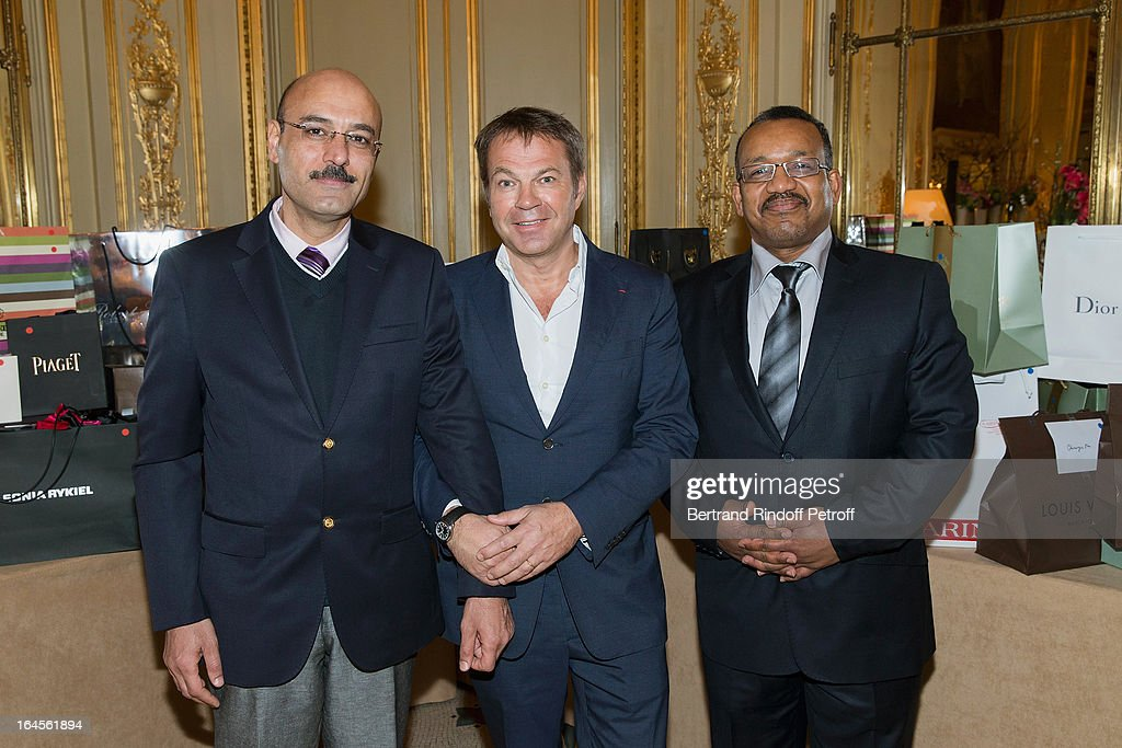 Dr Bertrand Matteoli (C), poses with Dr Sajjad F.N. Abu Alese (L) and Dr Bassim Al Sakere, both from Syria, as they attend the benefit party in aid of the 'Chirurgie Plus' (AC+) association at Hotel Meurice on March 24, 2013 in Paris, France.