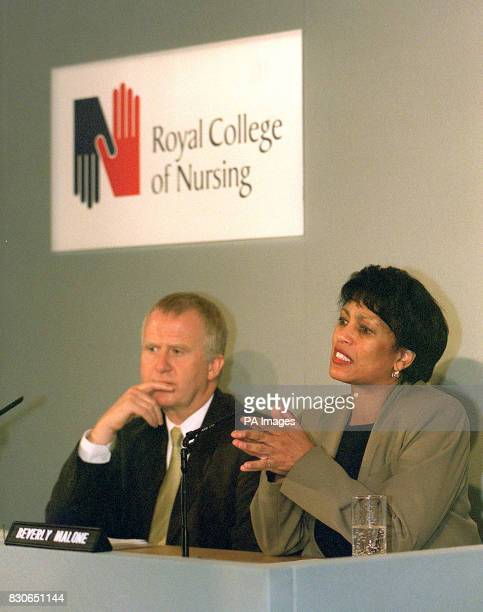 Dr Beverley Malone the new leader of Britain's nurses is watched by her deputy Tom Bolger at the Royal College of Nursing London as she criticises...