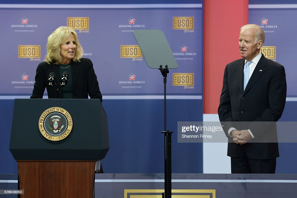 Dr Biden greets the troops as Vice President Biden looks on at the 75th Anniversary USO Show on May 5 2016 at Joint Base Andrews in Camp Springs...
