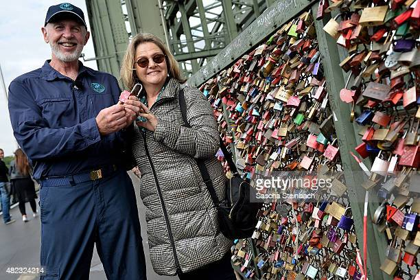Dr Bob and his wife Annette Miles pose during a photo call of 'Ich bin ein Star lasst mich wieder rein' at Hohenzollernbridge on July 30 2015 in...