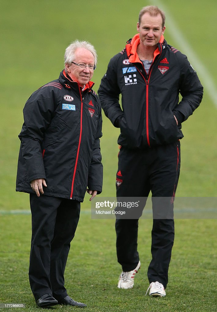 Dr Bruce Reid and assistant coach Sean Wellman look ahead during an Essendon Bombers AFL training session at Windy Hill on August 23 2013 in...