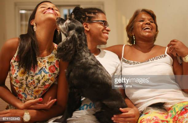 Dr êcaro Vidal dos Santos laughs with sister Isis Carine Vidal dos Santos and mother Raimunda Vidal dos Santos in his mother's home on April 18 2015...