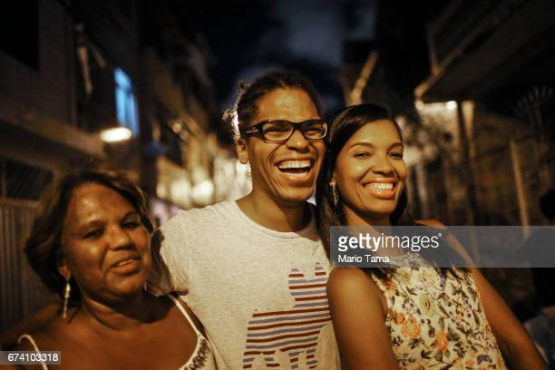 Dr êcaro Vidal dos Santos poses with sister Isis Carine Vidal dos Santos ¨ and mother Raimunda Vidal dos Santos outside his mother's home on April 18...