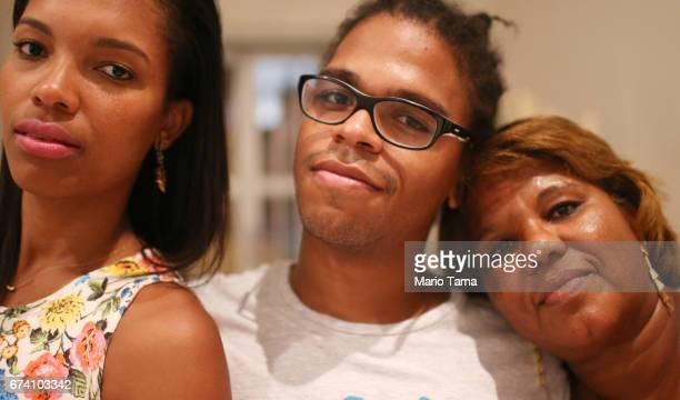 Dr êcaro Vidal dos Santos poses with sister Isis Carine Vidal dos Santos and mother Raimunda Vidal dos Santos in his mother's home on April 18 2015...