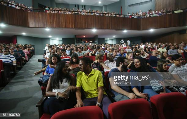 Dr êcaro Vidal sits with friend Thais Araujo while attending a theater performance on April 18 2015 in Salvador Brazil
