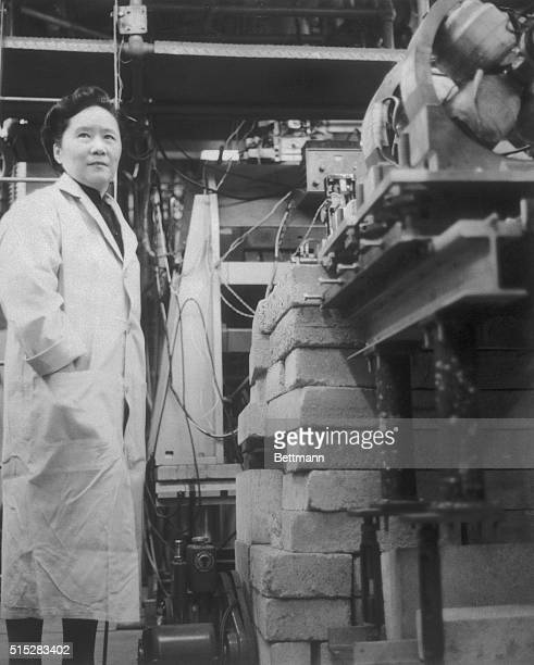 Dr ChienShiung Wu professor of Physics at Columbia University in New York is shown at work with the apparatus used in experimental work that...