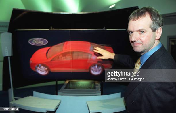Dr Chris Slinger from the UK Defence and Evaluation Research Agency part of the Ministry of Defence with a hologram of a Ford car at the launch in...