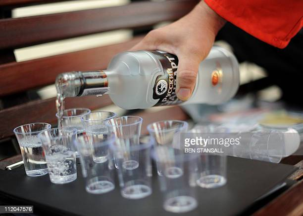 Dr Chris Welch pours vodka in glasses to mark a half century since Russian cosmonaut Yuri Gagarin became the first man in space in central London on...