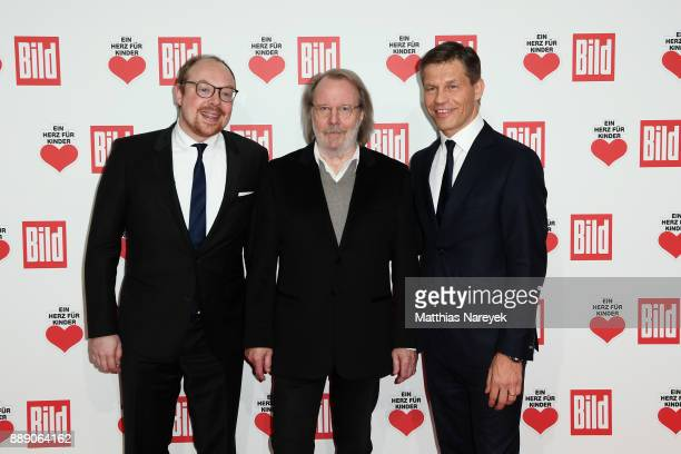 Dr Clemens Trautmann Benny Andersson and Frank Briegmann arrive at the Ein Herz Fuer Kinder Gala at Studio Berlin Adlershof on December 9 2017 in...