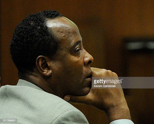 Dr Conrad Murray listens as defense attorney Ed Chernoff gives the defense's closing arguments during the final stage of Conrad Murray's defense in...