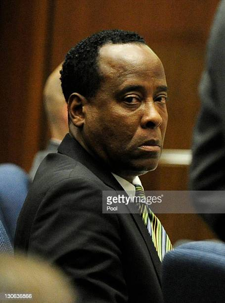 Dr Conrad Murray listens during testimony by Dr Paul White an anesthesiologist and propofol expert during the final stage of Murray's defense during...