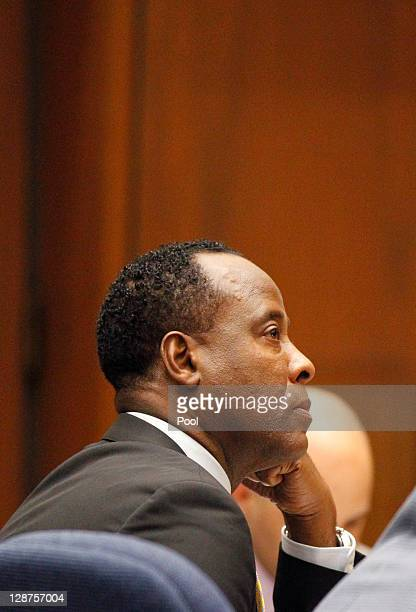 Dr Conrad Murray listens to audio recording made when he was interviewed by the LAPD during his involuntary manslaughter trial at the Los Angeles...