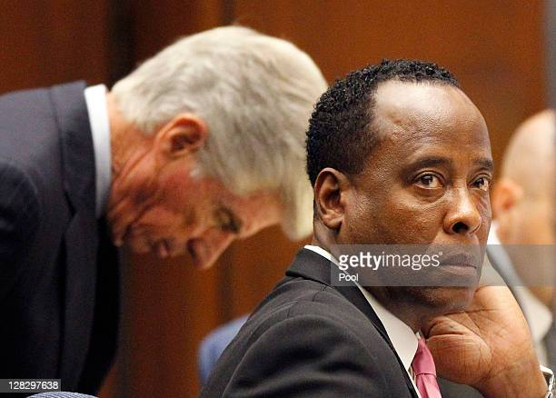 Dr Conrad Murray sits at the defense table with his attorney J Michael Flanagan during his involuntary manslaughter trial at the Los Angeles Superior...