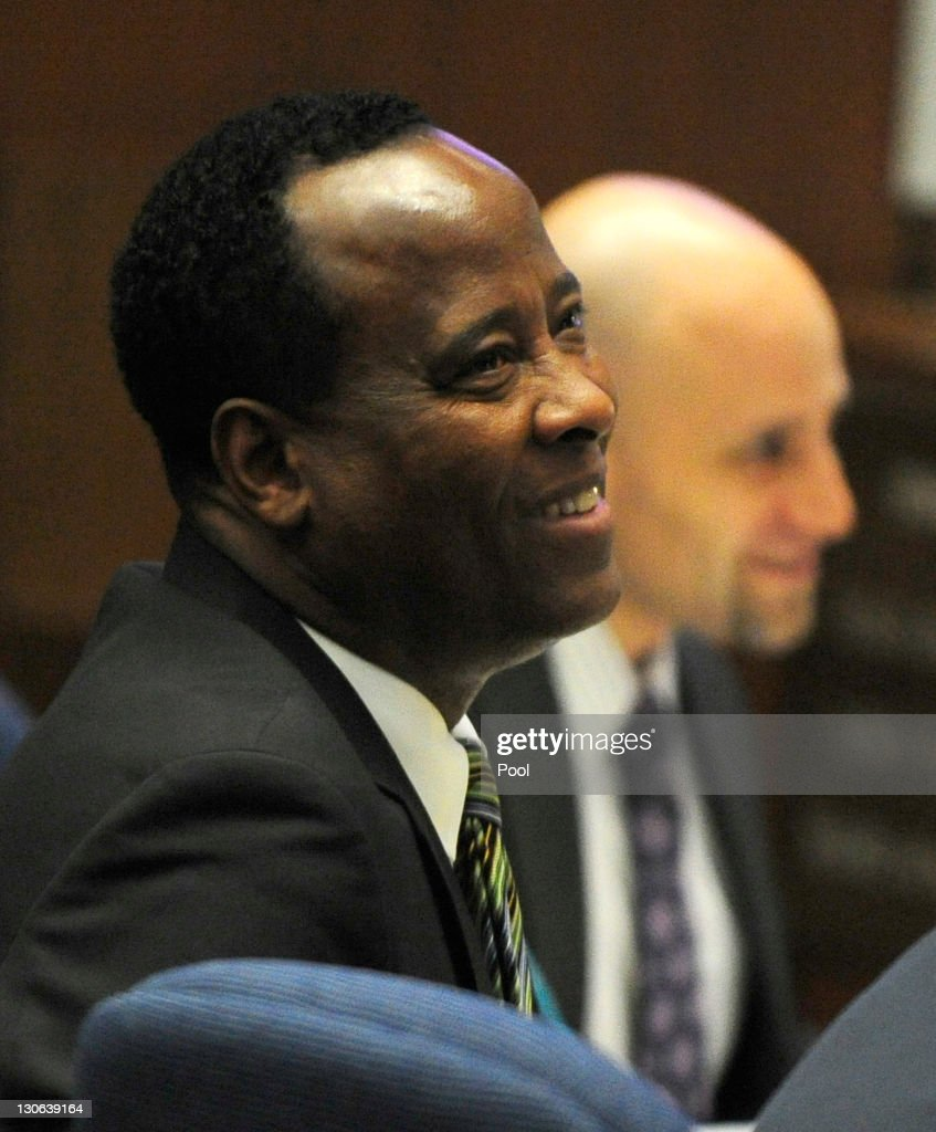 Dr. <a gi-track='captionPersonalityLinkClicked' href=/galleries/search?phrase=Conrad+Murray&family=editorial&specificpeople=5945898 ng-click='$event.stopPropagation()'>Conrad Murray</a> (L) smiles as he listens to testimony by Dr. Paul White, an anesthesiologist and propofol expert, as defense attorney Nareg Gourjian looks on (R) during the final stage of Murray's defense during his involuntary manslaughter trial in the death of singer Michael Jackson in Los Angeles Superior Court on October 27, 2011 in Los Angeles, California. Murray has pleaded not guilty and faces four years in prison and the loss of his medical licenses if convicted of involuntary manslaughter in Jackson's death.