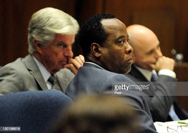 Dr Conrad Murray the former personal physician of the late singer Michael Jackson sits with his attorneys J Michael Flanagan and Nareg Gourjian...