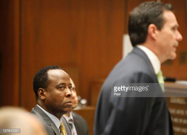 Dr Conrad Murray watches his attorney Edward Chernoff question concert promoter Paul Gongaware on the second day of his involuntary manslaughter...