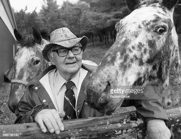 Dr Cornelius Thibeaut stands with two of his horses Nimrod left and Sidetrack on his farm in Ipswich Mass on Nov 10 1987