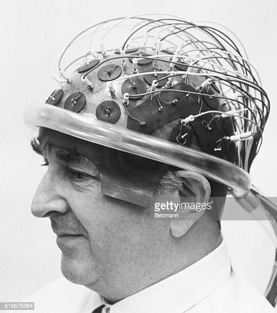 Dr Derek Fender tries on an electroencephalographic hat containing 80 electrodes to record brainwaves in response to visual stimuli Dr Fender...