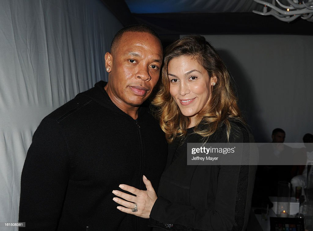 <a gi-track='captionPersonalityLinkClicked' href=/galleries/search?phrase=Dr.+Dre&family=editorial&specificpeople=211370 ng-click='$event.stopPropagation()'>Dr. Dre</a> and Nicole Threatt attend the Universal Music Group Chairman & CEO Lucian Grainge's annual Grammy Awards viewing party on February 10, 2013 in Brentwood, California.