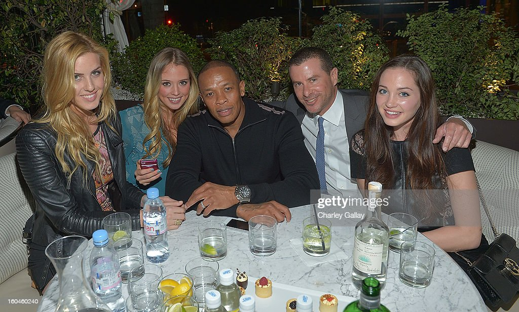 Dr. Dre (C) and partner of Innovative Dining Group Lee Maen (2nd R) attend the Grand Opening of RivaBella Ristorante on January 31, 2013 in West Hollywood, California.