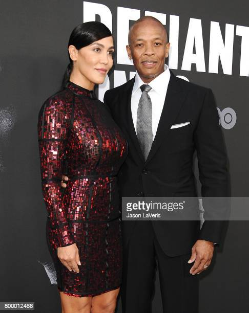 Dr Dre and wife Nicole Young attend the premiere of 'The Defiant Ones' at Paramount Theatre on June 22 2017 in Hollywood California