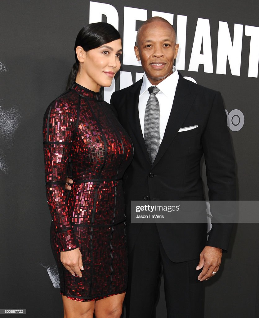 Dr. Dre and wife Nicole Young attend the premiere of 'The Defiant Ones' at Paramount Theatre on June 22, 2017 in Hollywood, California.