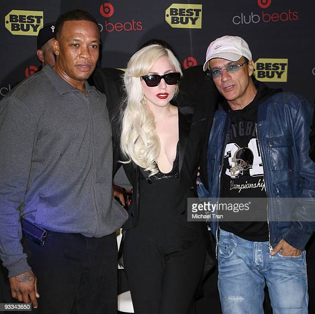 Dr Dre Lady Gaga and Interscope's Jimmy Iovine attend the debut of Lady Gaga's new album 'The Fame Monster' at Best Buy on November 23 2009 in Los...