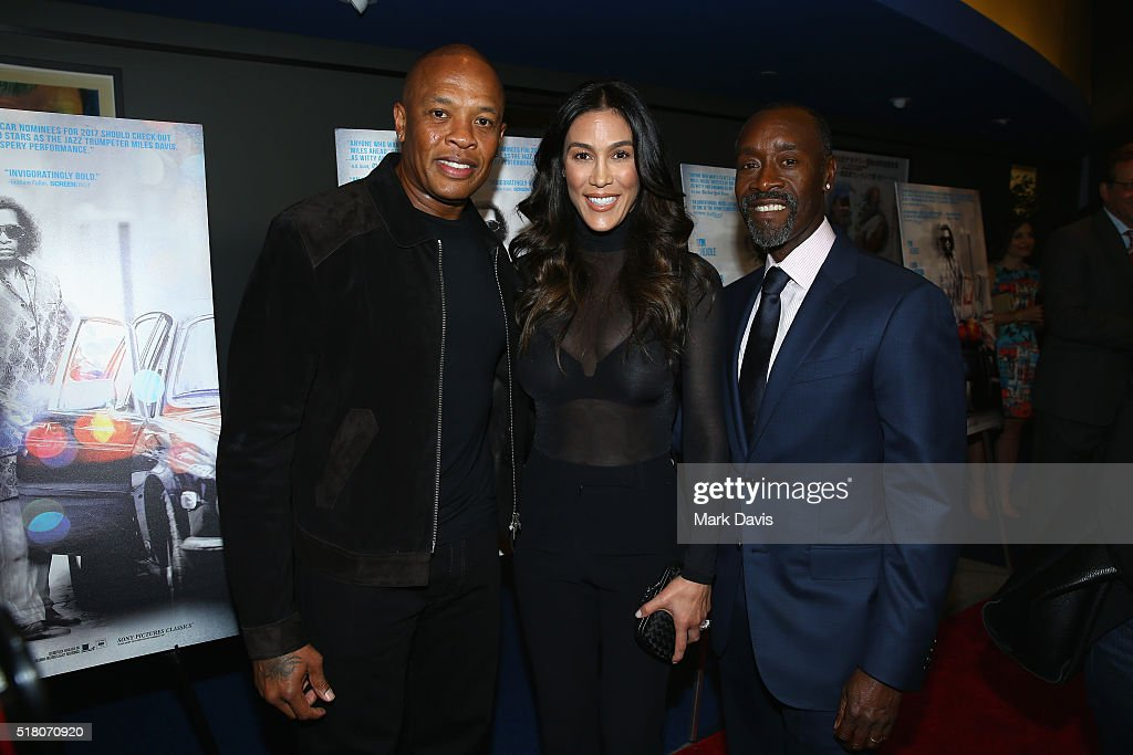 Dr. Dre, Nicole Young and director/actor Don Cheadle attend the premiere of Sony Pictures Classics' 'Miles Ahead' at Writers Guild Theater on March 29, 2016 in Beverly Hills, California.