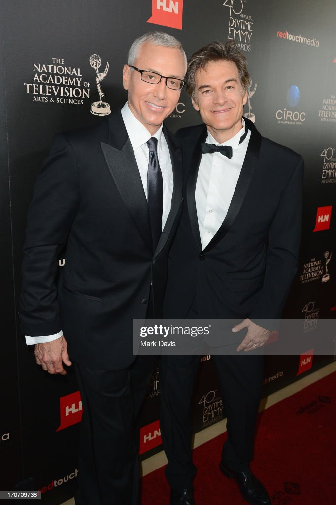 Dr. Drew Pinsky (L) and Dr. Mehmet Oz attend The 40th Annual Daytime Emmy Awards at The Beverly Hilton Hotel on June 16, 2013 in Beverly Hills, California.
