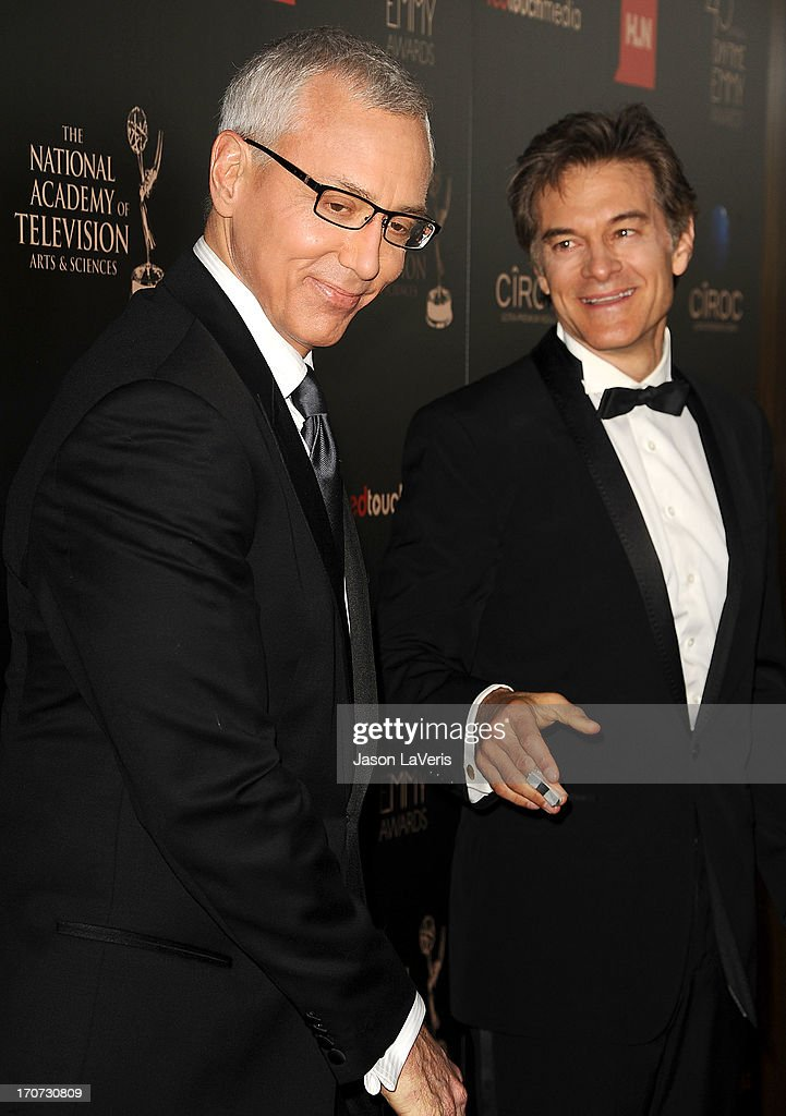 Dr. Drew Pinsky and Dr. Mehmet Oz attend the 40th annual Daytime Emmy Awards at The Beverly Hilton Hotel on June 16, 2013 in Beverly Hills, California.