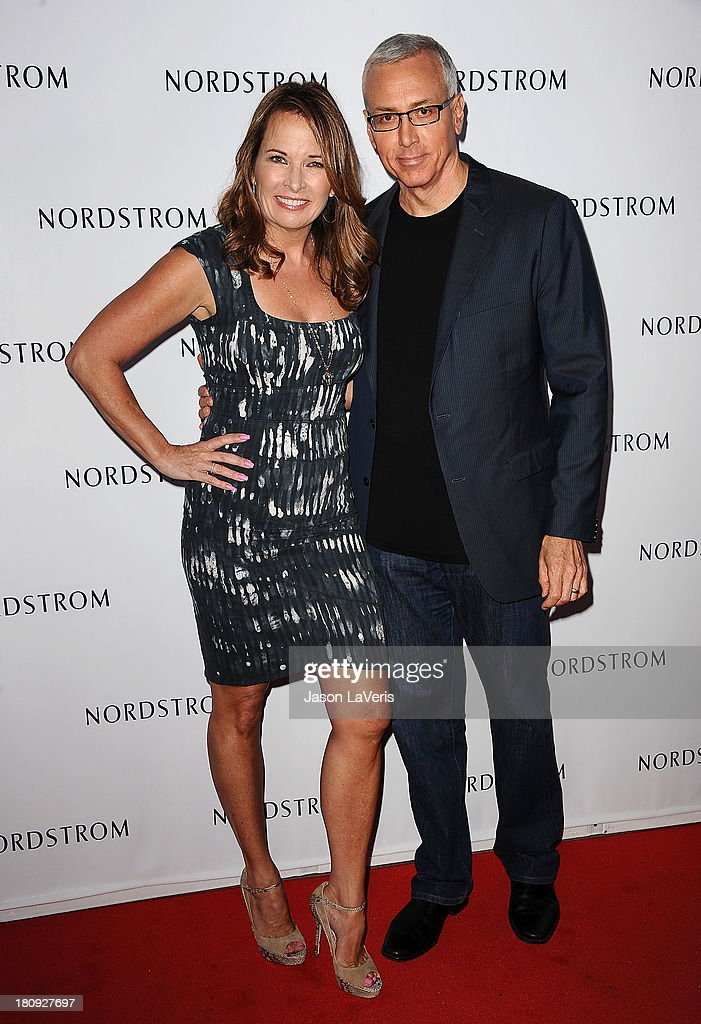 Dr. Drew Pinsky (R) and wife Susan Pinsky attend the opening gala to benefit Ascencia and Hillsides at Nordstrom at The Americana at Brand on September 17, 2013 in Glendale, California.