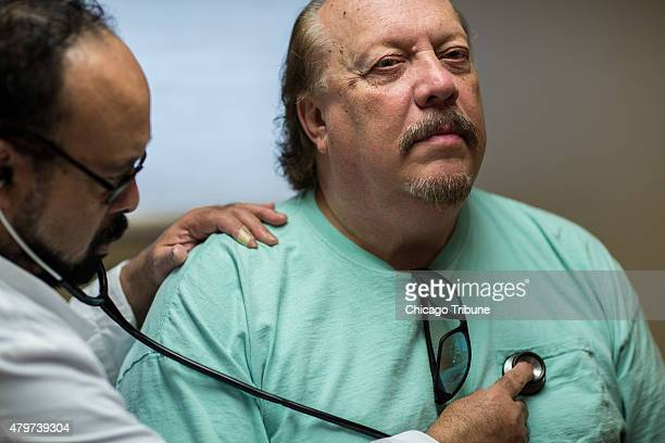 Dr Dwight Carson MD examines David Powell a medicaid patient enrolled in the Healthy Indiana Plan at the Heart City Health Center on Thursday June 4...