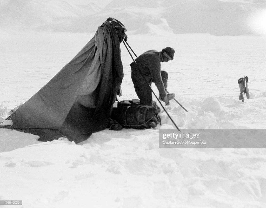 Dr Edward Wilson adjusting his footwear after sketching on the Beardmore Glacier photographed during the last, tragic voyage to Antarctica by Captain Robert Falcon Scott on 13th December 1911. Scott was tutored by Herbert Ponting, the renowned photographer who was the camera artist to the expedition, which enabled Scott to take his own memorable pictures before perishing on his return from the South Pole on or after 29th March 1912.