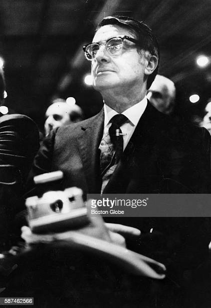 Dr Edwin Land holds a Polaroid camera during the annual meeting of stockholders in Needham Mass on April 23 1974
