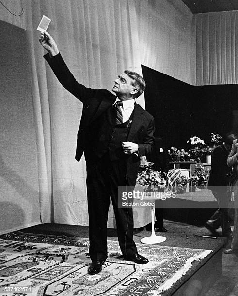 Dr Edwin Land shows off Polaroid's new SX70 color film to the press just before the annual meeting in Needham Mass on April 24 1979