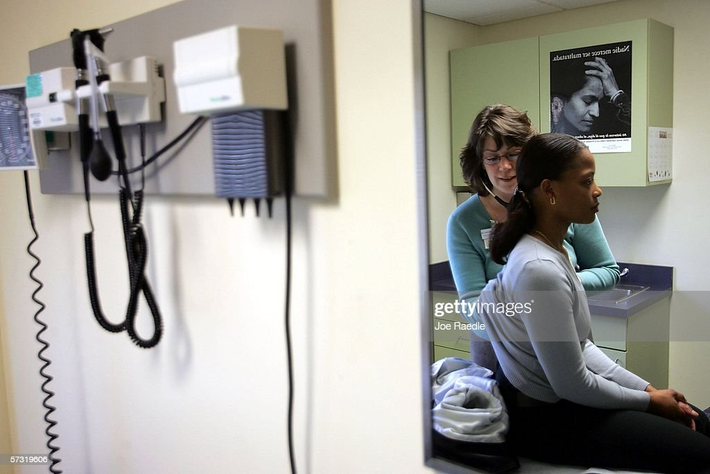 Dr. Elizabeth Maziarka uses a stethoscope during an examination of patient June Mendez at the Codman Square Health Center April 11, 2006 in Dorchester, Massachusetts. Massachusetts Governor Mitt Romney is scheduled to sign a health care reform bill April 12 that would make it the first state in the nation to require all its citizens have some form of health insurance.