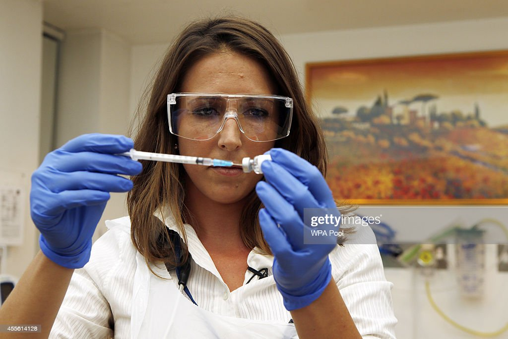 Dr Felicity Hartnell who is a clinical research fellow at Oxford University holds the vile of the ebola vaccine called Chimp Adenovirus type 3 before...