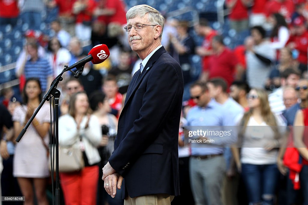 Dr. Francis Collins, Director of the National Institutes of Health, looks on after signing the national anthem at the start of the New York Mets against Washington Nationals game at Nationals Park on May 24, 2016 in Washington, DC.