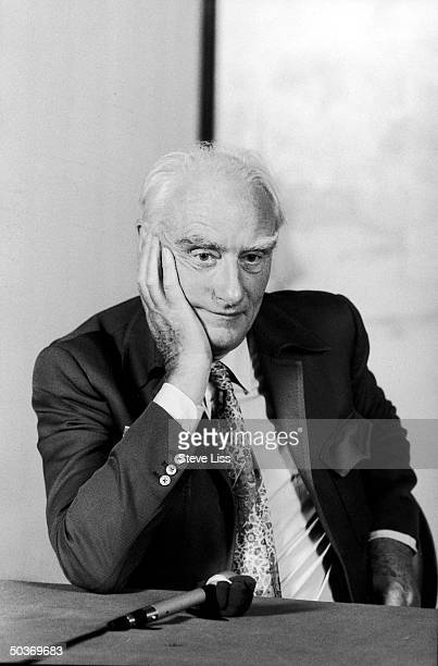 Dr Francis Crick w hand on cheek during press conference at symposium on molecular biology 30 Years of DNA at Park Plaza Hotel