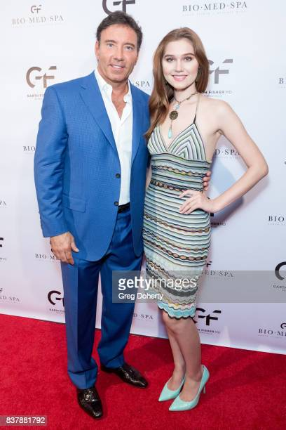 Dr Garth Fisher and Actress singersongwriter and model Serena Laurel attend the Official Launch Party Of Dr Garth Fisher's BioMed Spa at Garth Fisher...