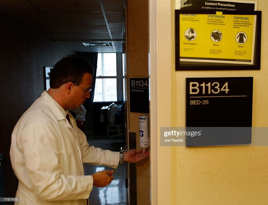 Dr Gio Baracco director of the Infectious Disease section of the University of Miami at the Miami VA hospital uses a alcohol based disinfectant to...