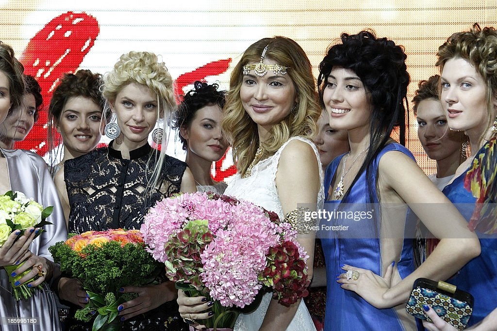 H.E. Dr <a gi-track='captionPersonalityLinkClicked' href=/galleries/search?phrase=Gulnara+Karimova&family=editorial&specificpeople=5748358 ng-click='$event.stopPropagation()'>Gulnara Karimova</a>, Chairwoman of the Board of Trustees Fund Forum surrounded by models, acknowledges applause following the Guli live show during Style.Uz Art Week 2013 at Ichan-Qala Hotel on October 26, 2013 in Tashkent, Uzbekistan.