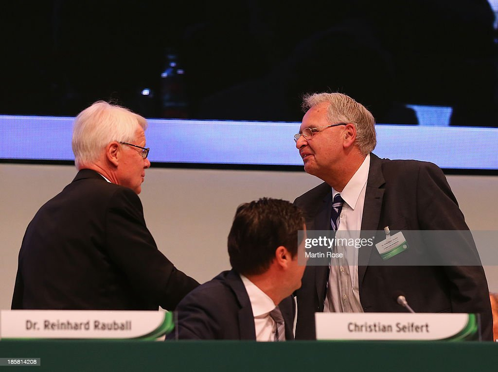 Dr. Hans-Dieter Drewitz (r) is congratulated by DFL league president Reinhard Rauball (l) after his election as a new member of the DFB executive board during the DFB Bundestag Day 2 at NCC Nuremberg on October 25, 2013 in Nuremberg, Germany.