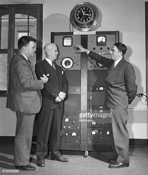 Dr Harold Lyons Chief of the Microwave Standards section Bureau of Standards explains some of the principles of the Atomic Clock to Dr Edward Condon...