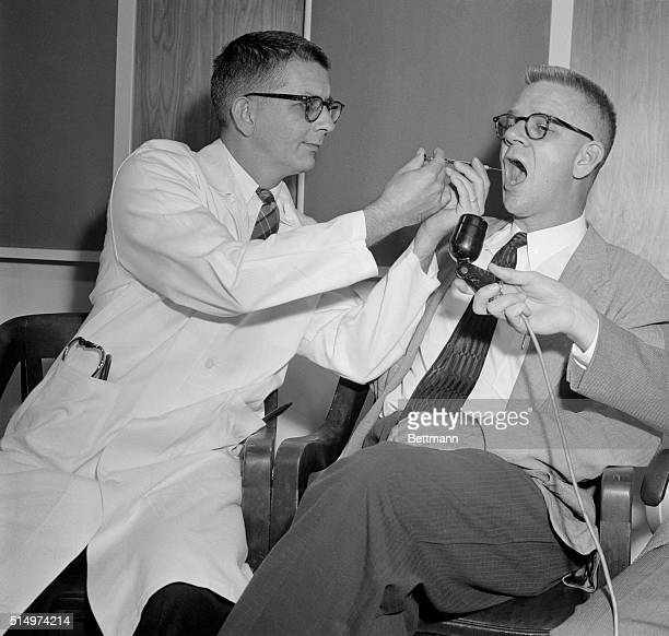 Dr Harry L Williams administers LSD 25 to Dr Carl Pfeiffer chairman of Emory University's Pharmacological Department to produce effects similar to...