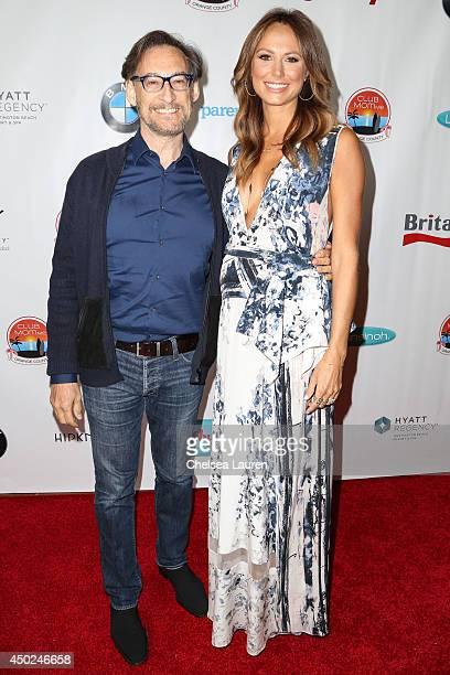 Dr Harvey Karp and actress/model Stacy Keibler arrive at the ClubMomMe Spring Fest at the Hyatt Regency Resort Spa on June 7 2014 in Huntington Beach...