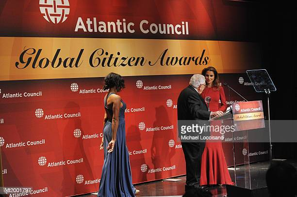 Dr Henry Kissinger presents Queen Rania of Jordan with the Atlantic Council Global Citizen award during the 2013 Global Citizen Awards Ceremony on...