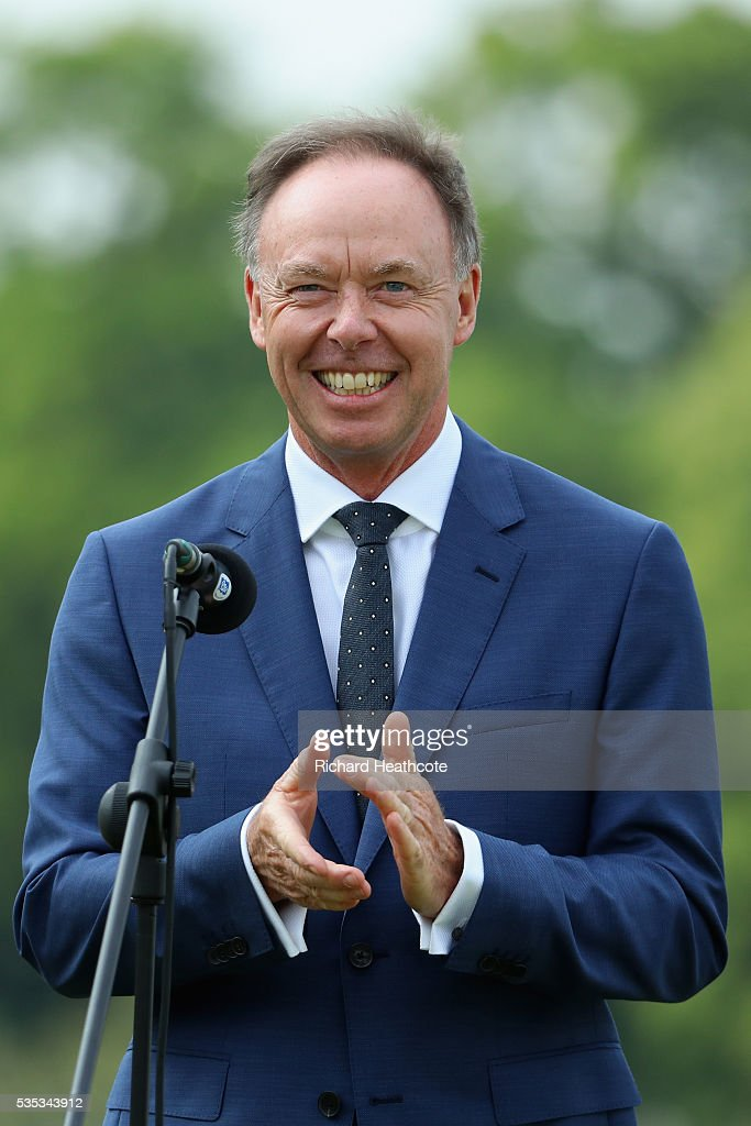 Dr Ian Robertson, Member of the Board BMW AG Sales applauds during day four of the BMW PGA Championship at Wentworth on May 29, 2016 in Virginia Water, England.